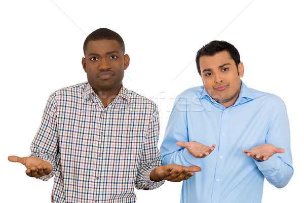 unhappy young men arms out saying we dont know  Stock photo © ichiosea