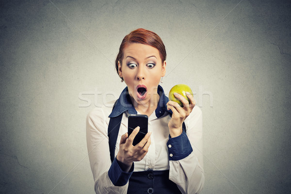 anxious shocked business woman looking at phone seeing bad news  Stock photo © ichiosea