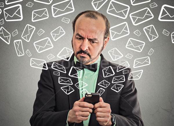 business man busy sending messages emails from smart phone  Stock photo © ichiosea