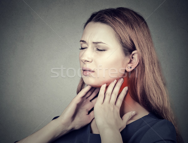 girl with sore throat neck colored in red. Sick woman having pain in throat Stock photo © ichiosea