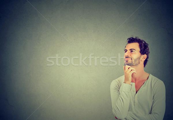 Boldog fiatalember gondolkodik álmodozás felfelé néz izolált Stock fotó © ichiosea