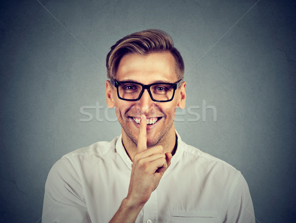 man with finger on lips Shhhh quiet, silence, secret gesture  Stock photo © ichiosea