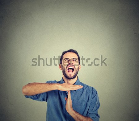 Young man showing time out hand gesture, frustrated screaming Stock photo © ichiosea