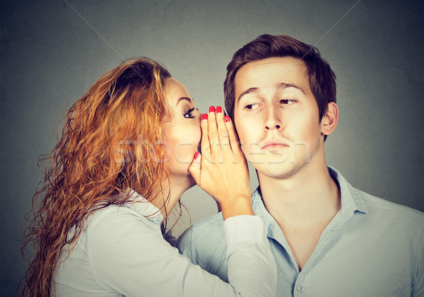 Speak in the ear. Woman whispering to handsome guy  Stock photo © ichiosea
