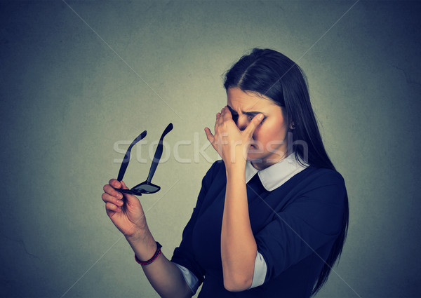 Woman with glasses rubbing her eyes feels tired  Stock photo © ichiosea