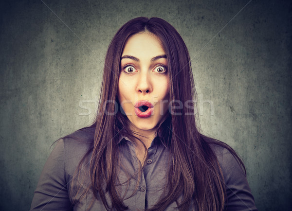 Portrait of a shocked girl Stock photo © ichiosea