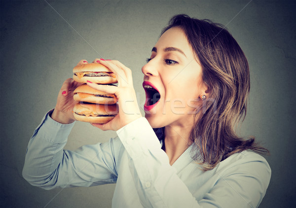 Woman eating craving a double burger  Stock photo © ichiosea