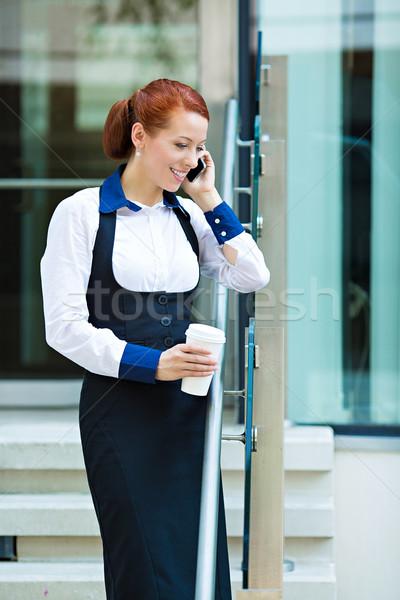 Company woman talking on smart phone on coffee break Stock photo © ichiosea