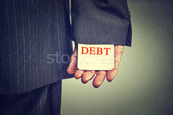 Debt concept. Closeup business man hiding debt card in a suit sleeve   Stock photo © ichiosea