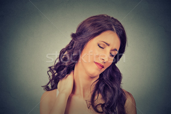 tired woman massaging her painful neck  Stock photo © ichiosea