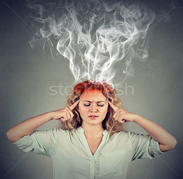 Woman thinks very intensely having headache Stock photo © ichiosea