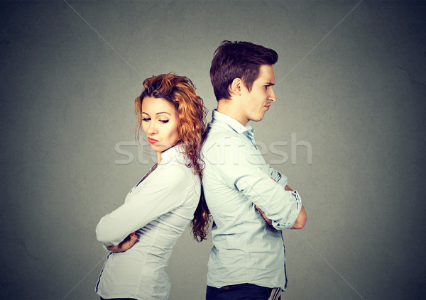 Angry frustrated young couple standing back to back Stock photo © ichiosea