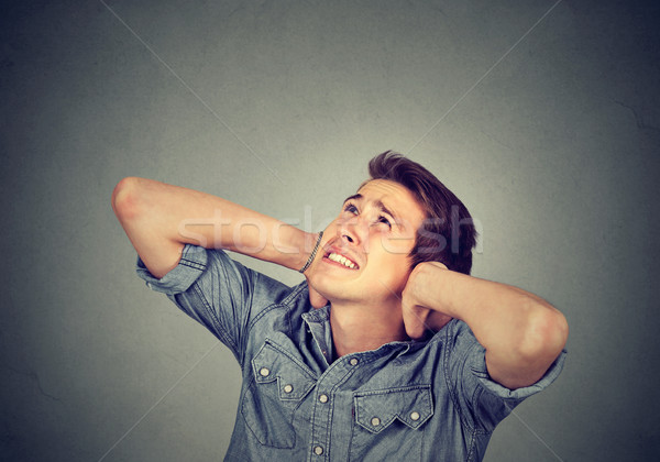 annoyed stressed man covering his ears looking up Stock photo © ichiosea