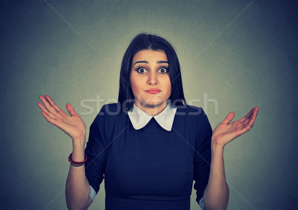 dumb looking woman arms out shrugs shoulders I don't know  Stock photo © ichiosea