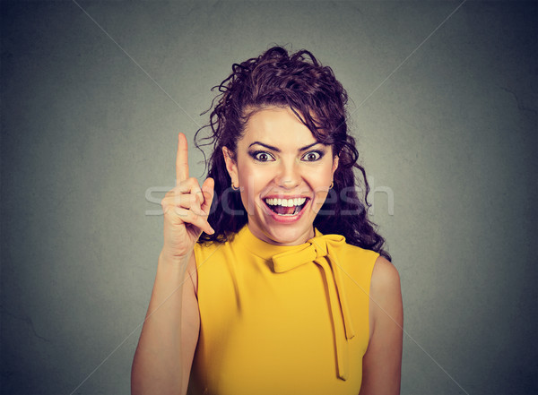 Attractive woman pointing finger up has an idea  Stock photo © ichiosea