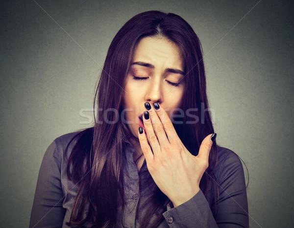 sleepy woman yawning looking bored Stock photo © ichiosea