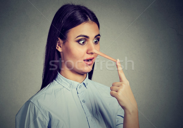 Stock photo: Liar woman with long nose