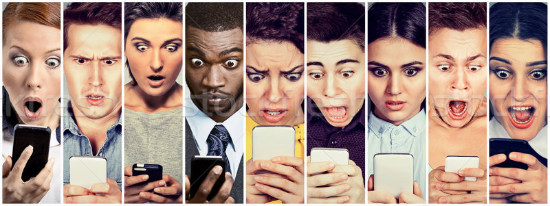 Group of people men and women looking shocked at mobile phone  Stock photo © ichiosea
