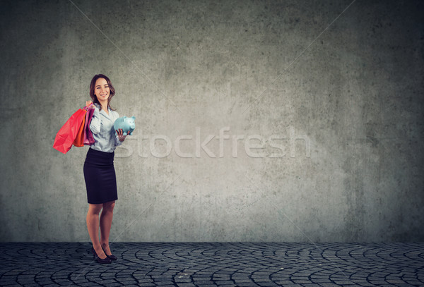 Woman spending money on shopping Stock photo © ichiosea
