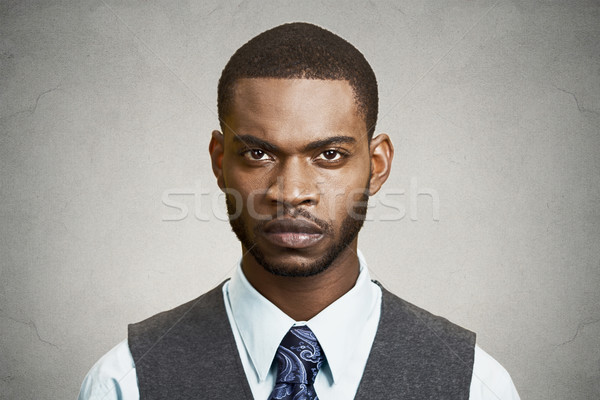 Headshot of a skeptical, serious business man Stock photo © ichiosea