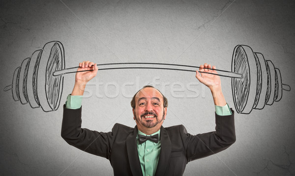 businessman holding hand sketched barbell Stock photo © ichiosea