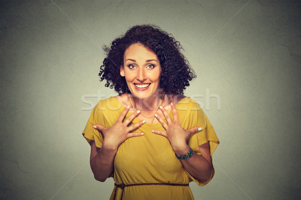 happy woman looking excited, surprised in full disbelief, hands on chest, it's me?  Stock photo © ichiosea