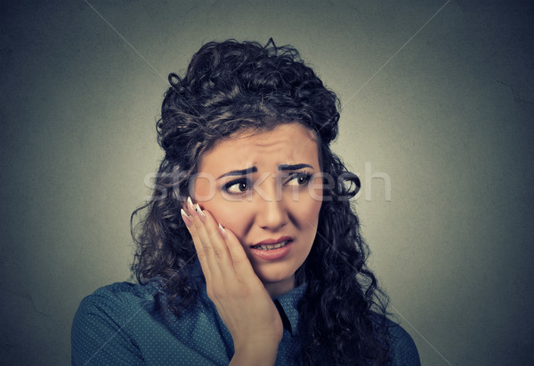 young woman with sensitive toothache crown problem about to cry from pain Stock photo © ichiosea