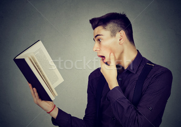Amazed shocked man reading a book  Stock photo © ichiosea