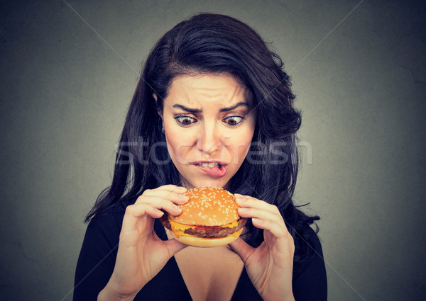 Young woman craving a tasty burger   Stock photo © ichiosea