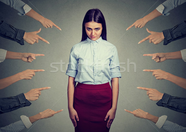 accusation of guilty person. Upset woman, many fingers pointing at her Stock photo © ichiosea