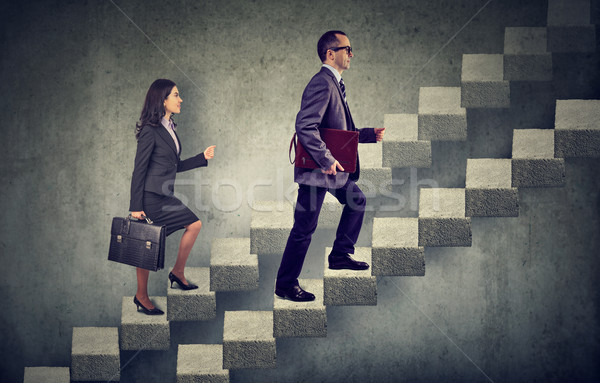 business woman and man with briefcase stepping up a stairway career ladder  Stock photo © ichiosea