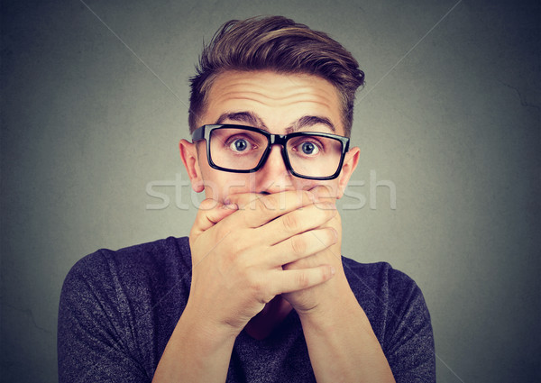 Portrait of a shocked man covering his mouth with hands Stock photo © ichiosea