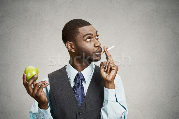 Man smoking cigarette, instead of making healthy choices Stock photo © ichiosea