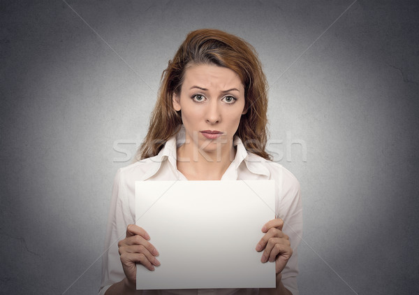 Unhappy woman holding blank card banner Stock photo © ichiosea