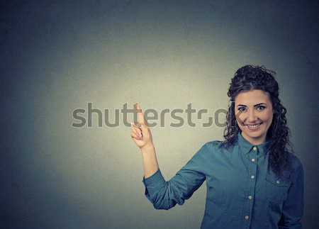 Attractive young woman pointing at blank copy space  Stock photo © ichiosea
