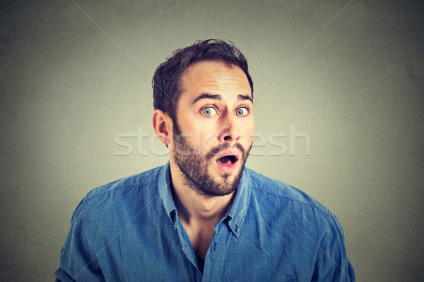 Portrait of a shocked young man in full disbelief   Stock photo © ichiosea