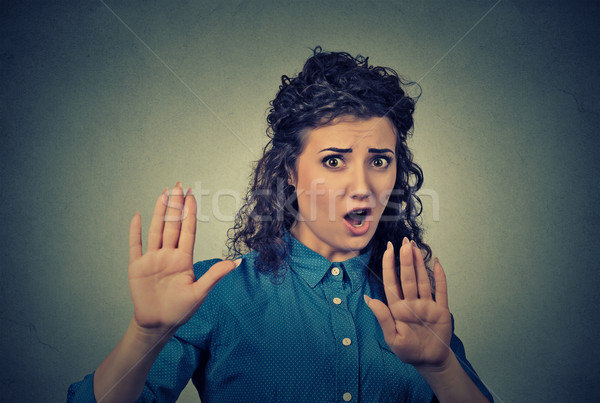 annoyed angry woman with bad attitude gesturing with palms outward screaming to stop Stock photo © ichiosea