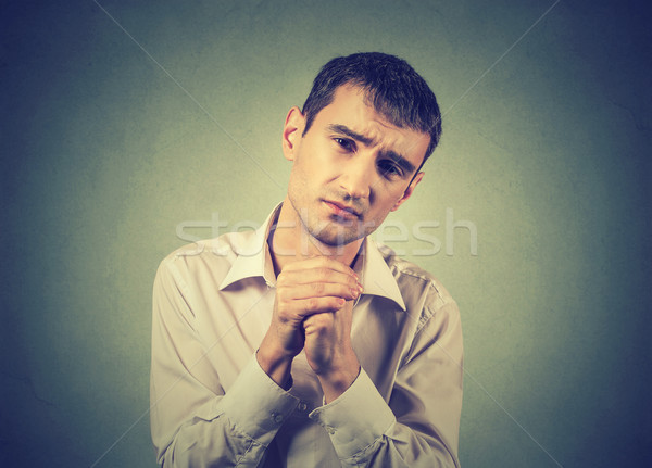 desperate young man showing clasped hands, please forgive me  Stock photo © ichiosea