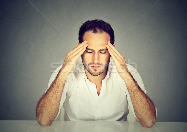 Sad stressed man thinking intensely concentrating preoccupied  Stock photo © ichiosea