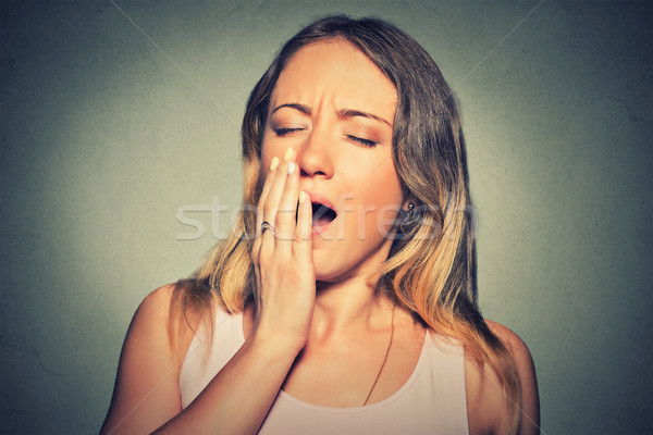 sleepy young woman with wide open mouth yawning eyes closed looking bored Stock photo © ichiosea