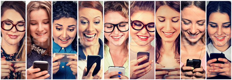 Multiethnic group of happy women using their phones sending sms  Stock photo © ichiosea