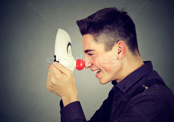 Laughing young man with clown mask  Stock photo © ichiosea