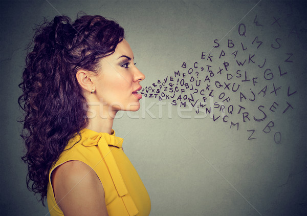 Woman talking with alphabet letters coming out of her mouth Stock photo © ichiosea