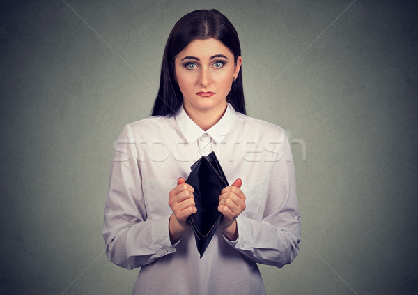 Woman with no money. Businesswoman holding showing empty wallet Stock photo © ichiosea