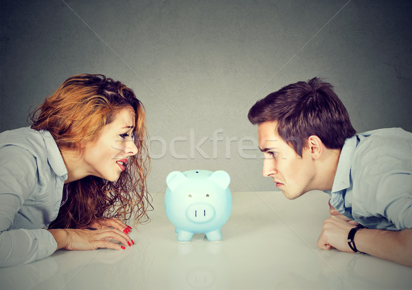 Finances in divorce concept. Wife and husband can not make settlement looking at piggy bank sitting  Stock photo © ichiosea