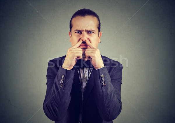 Man suffering from bad smell Stock photo © ichiosea