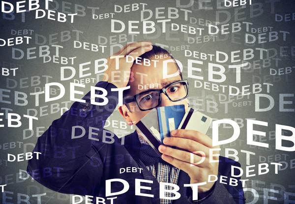 Młody człowiek karty kredytowej długi człowiek patrząc Zdjęcia stock © ichiosea