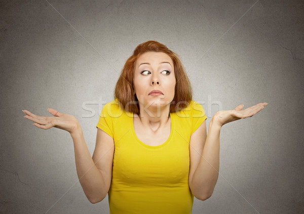 Clueless woman with arms out shrugs shoulders Stock photo © ichiosea