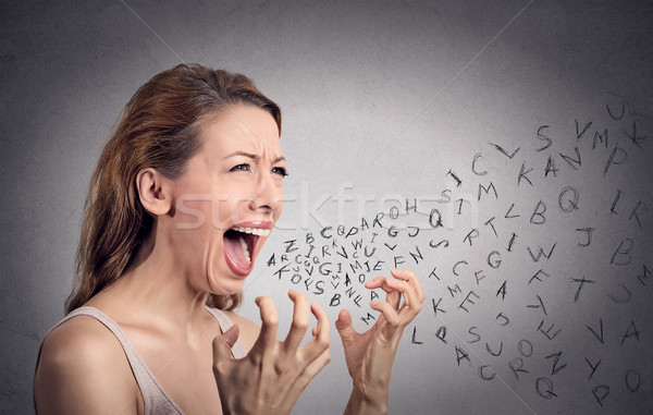 angry woman screaming, alphabet letters coming out of mouth Stock photo © ichiosea