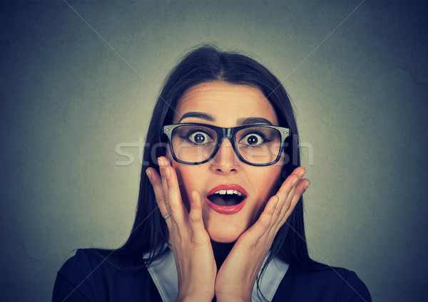 Woman looking excited with mouth opened shocked surprised stunned Stock photo © ichiosea